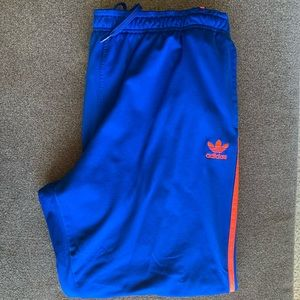 Men's Adidas blue and orange track pants